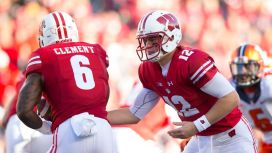 wisconsin-badgers-quarterback-alex-hornibrook-hands-the-football-off-to-running-back-corey-clement-during-the-first-quarter-against-the-illinois-fighting-illini-at-camp-randall-stadium-in-madison-wis